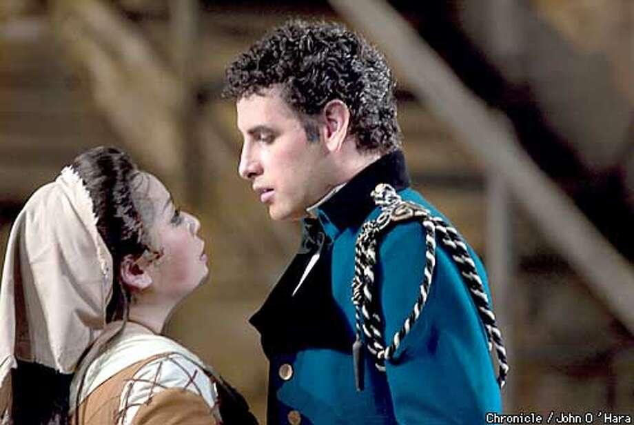 "SF Opera, performs Rossini's ""Cinderella""  Angelina La Cenerentola (Cinderella)/Mika Shigematsu  Clorinda (sister, blonde, freckles)/Saundra DeAthos  Tisbe (sister, red hair, big nose)/Catherine Cook  Alidoro, (Beggar & Man with book)/Eike Wilm Schulte  Don Magnifico (Fat stepfather)/Kevin Garvin  Don Ramiro (green outfit)/ Juan Diego Florez  Dandini (prince with small mustache)/ Daniel Belcher 6/4/03 in San Francisco."