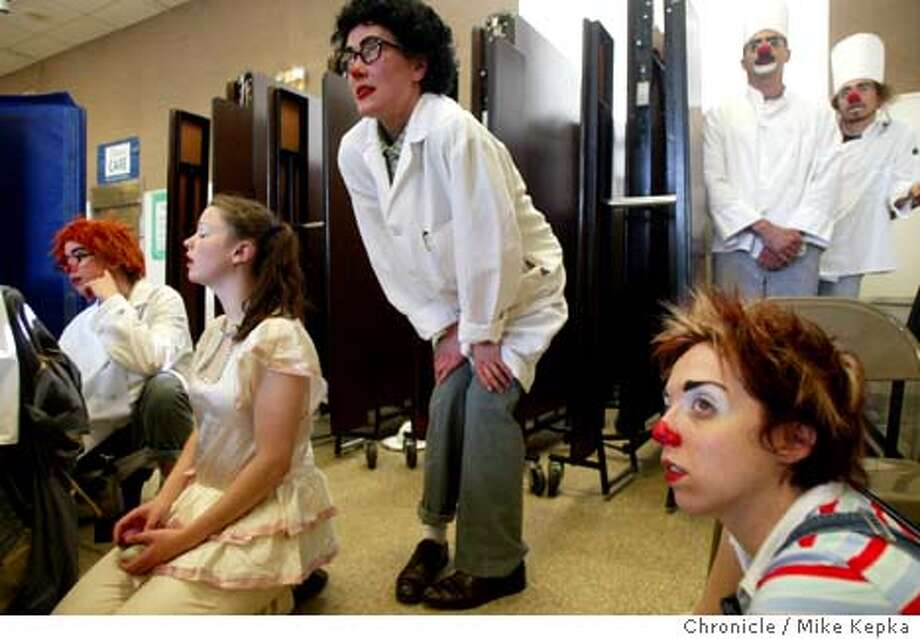 At Paden Elementary School in Alameda, Jeni Johnson watches for her next cue during the last day of community performaces. Jeni (cq) Johnson, 32, of Oakland is one of 11 members of the third graduating class from the Clown Conservatory in San Francisco. The year long program comes to an end with a group of community performances done around the bay area. 5/28/03 in San Francisco. MIKE KEPKA / The San Francisco Chronicle Photo: MIKE KEPKA