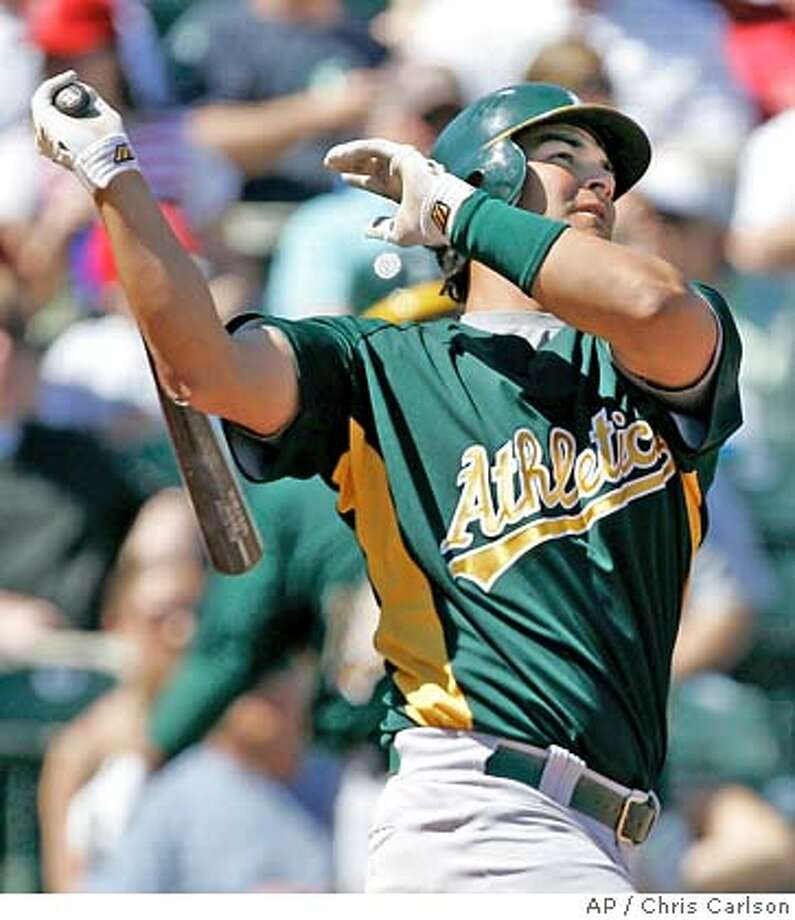Oakland Athletics' Eric Chavez watches his solo homer against the Los Angeles Angels during the first inning of their spring training baseball game in Tempe, Ariz., Sunday, March 11, 2007. (AP Photo/Chris Carlson) Photo: Chris Carlson