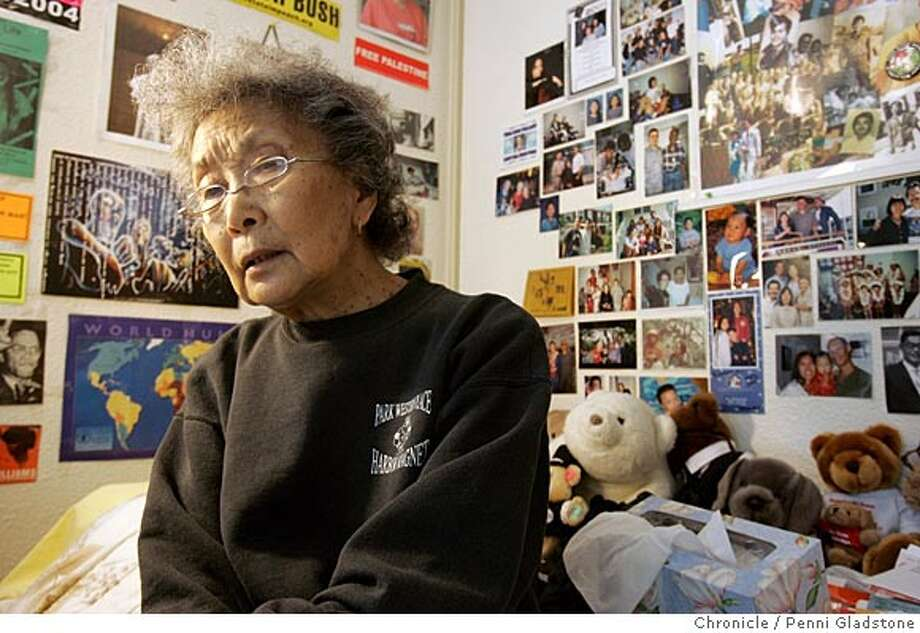 EBKOCHIYAMA__0026_PG.JPG sitting on her bed covered with notes and corespondence,& political signs are all over her room, she speaks with much thought.  Yuri Kochiyama, social and political activitist at her apt in a sr. living facility.  San Francisco Chronicle, Penni Gladstone  Photo taken on 8/23/05, in Oakland, Photo: Penni Gladstone