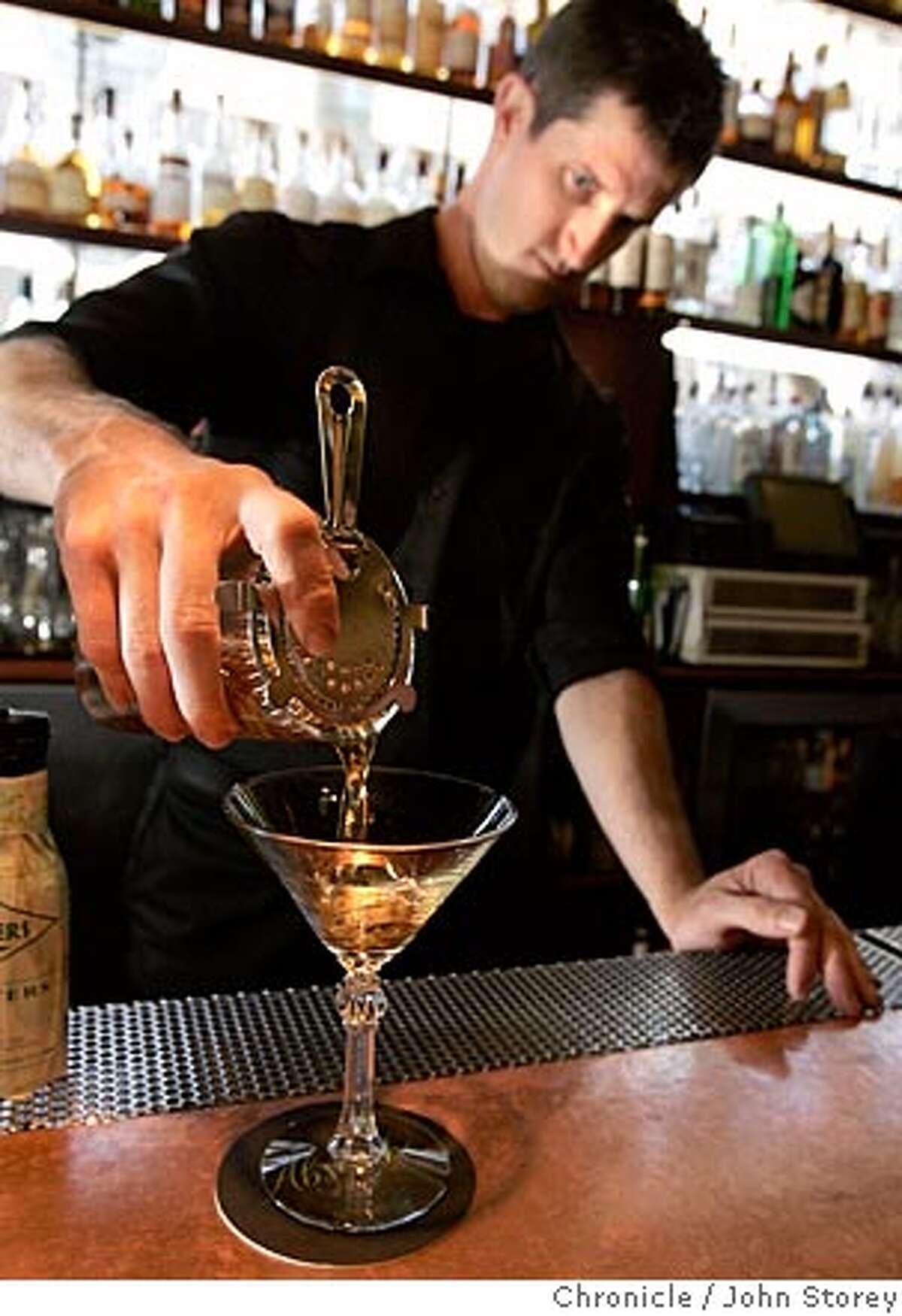 "Bartender Jonny Raglin mixes the ""Bob Tailed Nag"" at Absinthe Brasserie & Bar. John Storey San Francisco Event on 8/31/05 -"