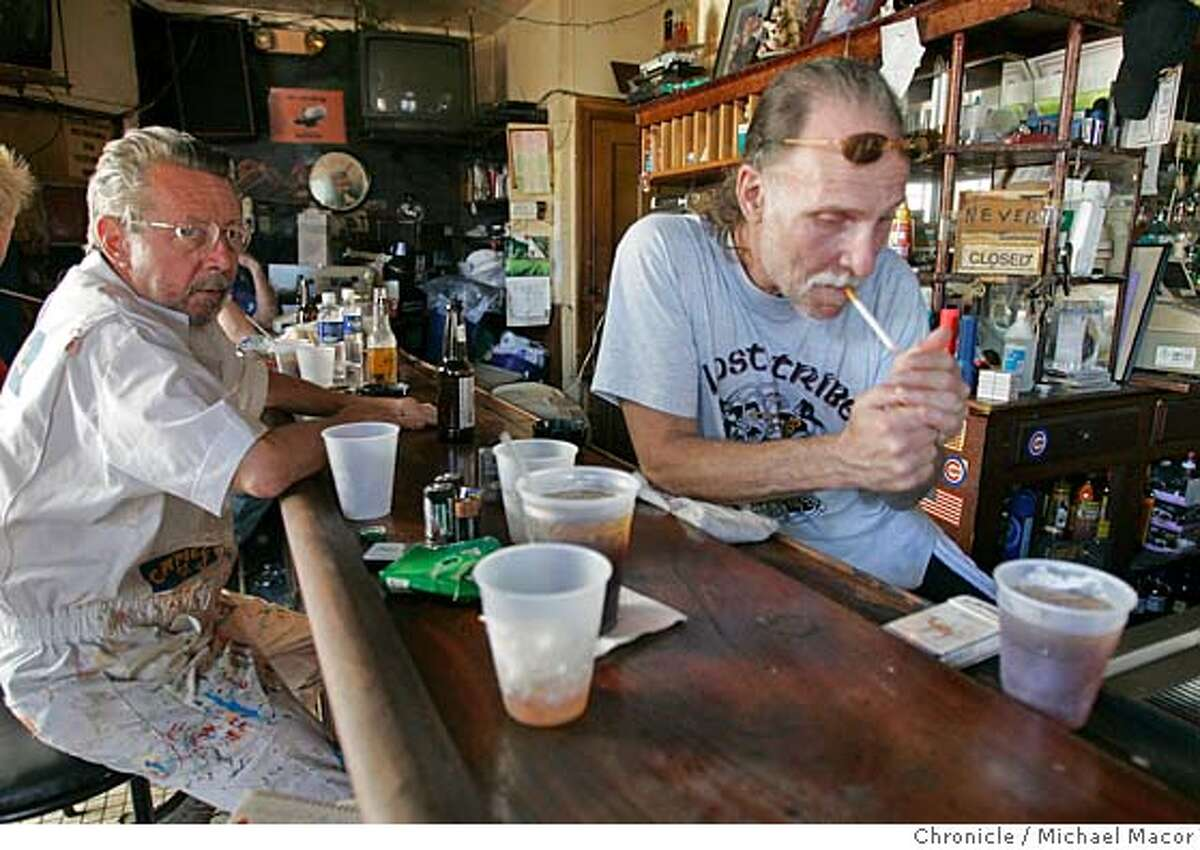 katrina4_329_mac.jpg Regular, James LaLand, left and bartender Larry Hirst. A visit to Johnny White's Sports Bar in the French Quarter. The bar has been open 24/7 even before the hurricane hit New Orleans. The aftermath of Hurricane Katrina that ravaged the gulf coast states, New Orleans, Louisiana. 9/7/05 New Orleans , La Michael Macor / San Francisco Chronicle Mandatory Credit for Photographer and San Francisco Chronicle/ - Magazine Out