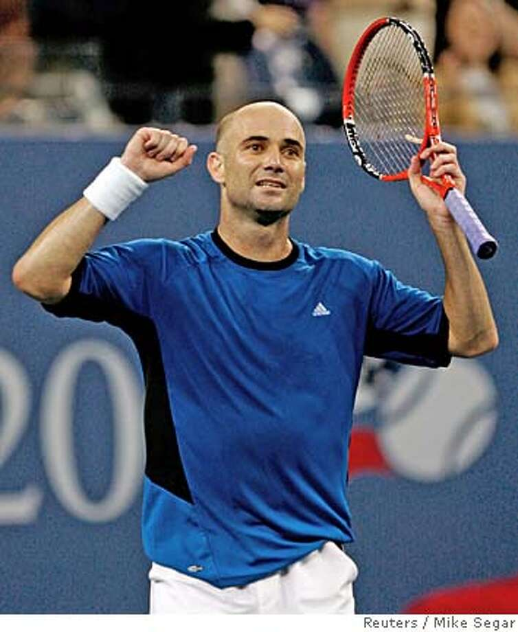 Andre Agassi of the U.S. celebrates his win over compatriot James Blake in their quarterfinal match at the U.S. Open tennis tournament in Flushing Meadows, New York, September 7, 2005. Agassi won the match 3-6 3-6 6-3 6-3 7- 6 REUTERS/Mike Segar 0 Photo: MIKE SEGAR