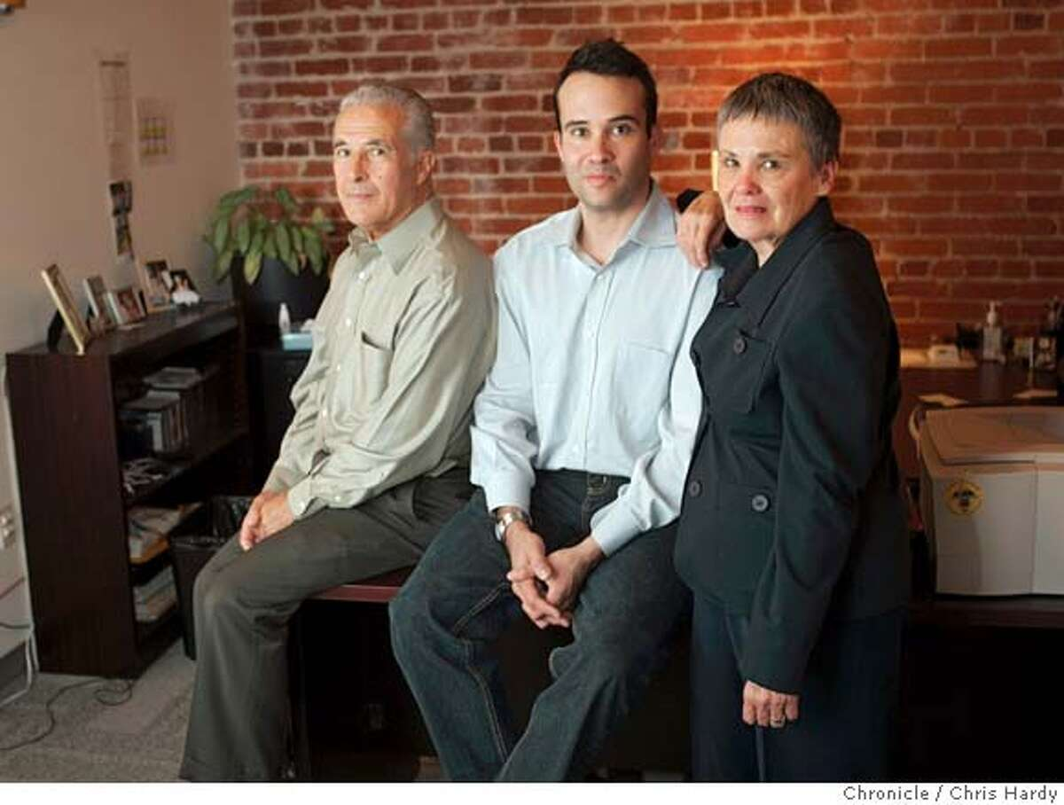 Rapt CEO Tom Chavez, center, and his parents Ray and Rosario in his office. in San Francisco 8/25/05 Chris Hardy / San Francisco Chronicle