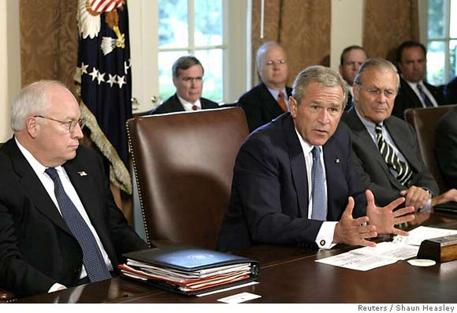 U.S. President George W. Bush gestures after meeting with members of his cabinet in the Cabinet Room at the White House in Washington September 6, 2005. REUTERS/Shaun Heasley Photo: SHAUN HEASLEY