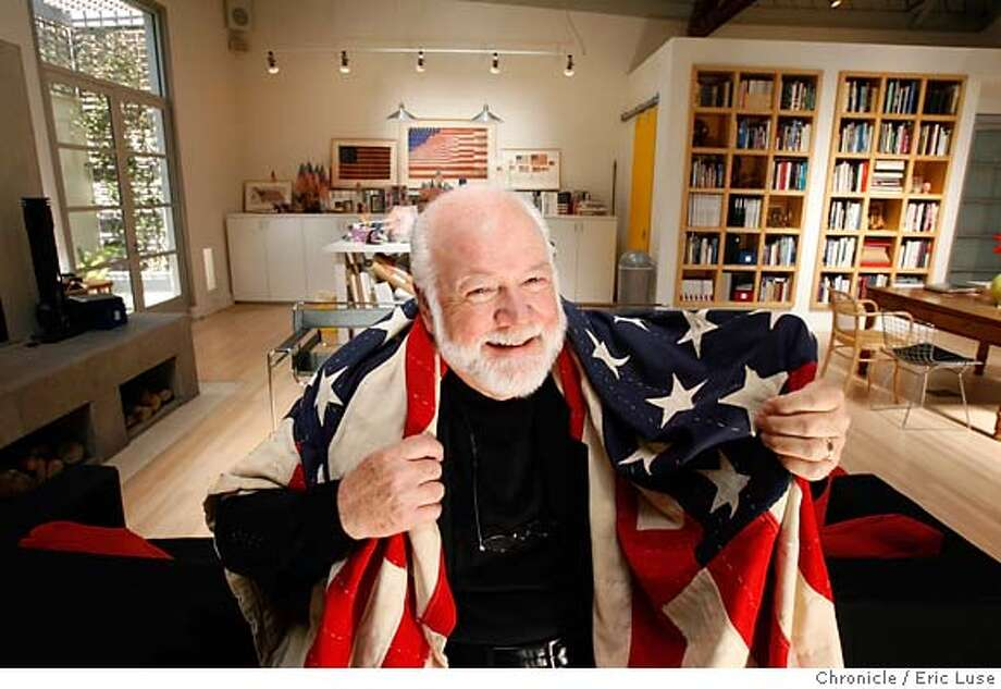 collectorsxx_0163_el.JPG  Kit wrapped up in a wool flag quilt made from real flags from Tennessee in the early 1900's. His flag work area is behind him which was once the painter's studio of a former owner.  Kit Hinrichs collects American flag memorabilia which is well displayed in his San Francisco home he shares with his wife Linda. Photographer:  Eric Luse / The Chronicle names cq from source MANDATORY CREDIT FOR PHOTOG AND SF CHRONICLE/NO SALES-MAGS OUT Photo: Eric Luse