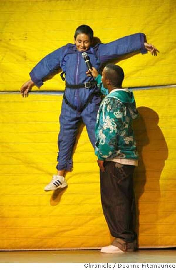 hiphopscience14_024_df.jpg  Omar Navarro (cq) wears a velcro suit and hangs from a velcro wall. He is being interviewed on stage by Lars-Eric Brown (cq) Sixth grade students from Barnard-White Middle School in Union City borrowed the gymnasium of Conley Carabello High School to watch a performance of FMA Live, a lively event on stage to help promote understanding of Sir Isaac Newton's Laws of Motion. Photographed in Hayward on 3/13/07. Deanne Fitzmaurice / The Chronicle Omar Navarro (program director)  Lars-Eric Brown (program director) Mandatory credit for photographer and San Francisco Chronicle. No Sales/Magazines out. Photo: Deanne Fitzmaurice