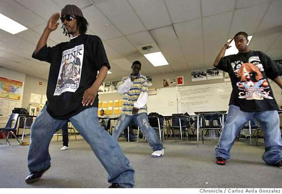 ARCHITECKZ_003_CAG.JPG  Jeriel Bey of the dance group Architeckz teaches his dance techniques to students, Toby hall, right, and Fred Lawson, center, at Berkeley High School on Thursday, March 8, 2007. The group, founded in West Oakland in 2002, is on the cutting edge of an effort to channel the energy of young people into non-violent activities through turf dancing, in which groups try to outdo each other in a modern version of break dancing. On Sunday, March 11th, Architeckz will face off against a turf dancing team from Memphis in a fundraiser for youth programs in Oakland.  Photo by Carlos Avila Gonzalez/The San Francisco Chronicle  Photo taken on 3/8/07, in Berkeley, Ca, USA.  **All names cq (source) MANDATORY CREDIT FOR PHOTOG AND SAN FRANCISCO CHRONICLE/NO SALES-MAGS OUT Photo: Carlos Avila Gonzalez