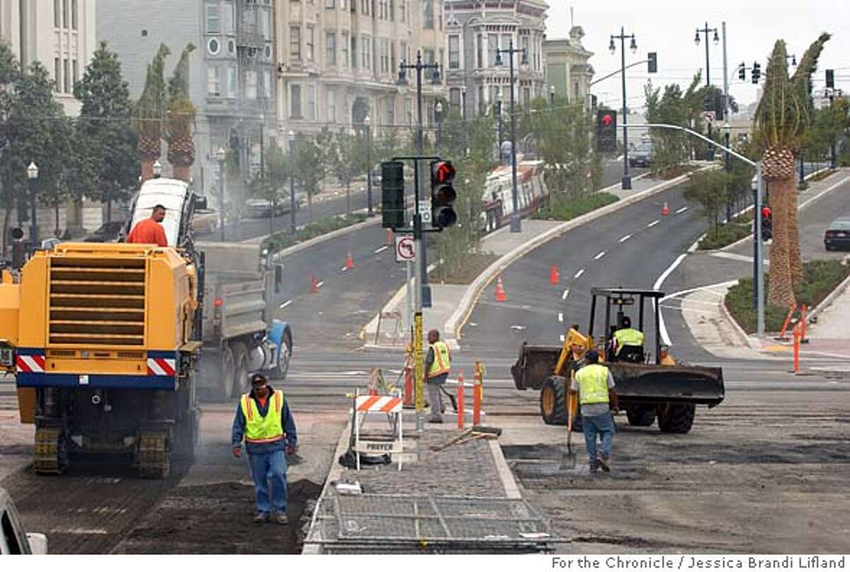 Construction workers were putting the finishing touches on the new Central Freeway offramp at the intersection of Octavia and Market Streets. They were removing barricades, landscaping, laying brick and cleaning the streets on Wednesday morning. San Francisco, California. Wednesday, September 7, 2005. Photo by Jessica Brandi Lifland/For The Chronicle