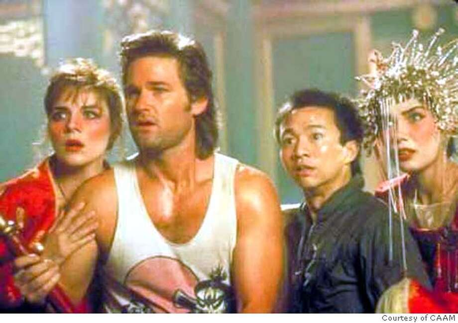 "'Big Trouble in Little China'- Kurt Russel stars in the so-schlocky-it's-fun ""Big Trouble in Little China."""