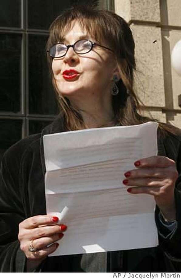 Deborah Palfrey of Vallejo, Calif., reads a statement outside federal court in Washington, Friday, March 9, 2007, after her arraignment on federal racketeering charges. (AP Photo/Jacquelyn Martin) Photo: Jacquelyn Martin