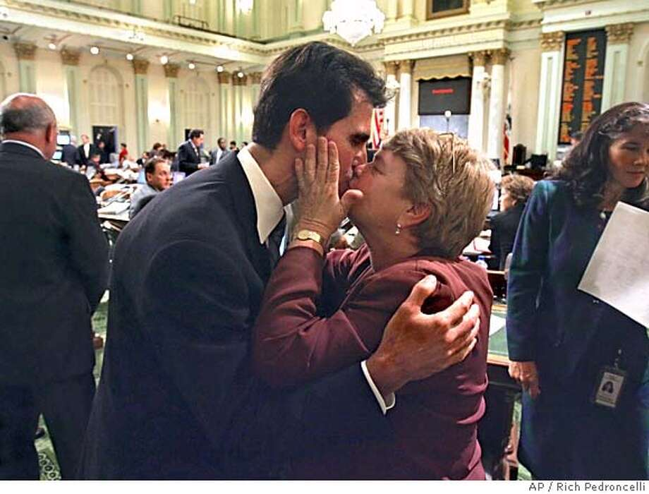 Assemblyman Mark Leno, D-San Francisco, left, gets a kiss from state Sen. Sheila Kuehl, D-Santa Monica, after his same-sex marriage measure was passed by the Assembly at the Capitol in Sacramento, Calif., Tuesday, Sept. 6, 2005. The California Legislature became the first legislative body in the U.S. to approve same-sex marriages, as gay-rights advocates overcame two earlier defeats in the Assembly. The 41-35 vote sends the bill to Gov. Arnold Schwarzenegger, whose office had no comment on the bill when it cleared the state Senate last week. (AP Photo/Rich Pedroncelli) Photo: RICH PEDRONCELLI