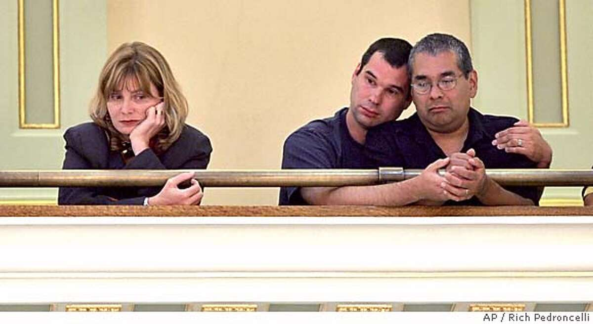 Members of the Gay and Lesbian community, Mark Guzman, right, and his partner Scott Coatsworth, center, along Mary McKay, of Equality California sit in the Assembly gallery as lawmakers debate Assemblyman Mark Leno's, D-San Francisco, same-sex marriage measure at the Capitol in Sacramento, Calif., Tuesday, Sept. 6, 2005. By a 41-35 vote the Assembly approved the bill making California Legislature the first legislative body in the country to allow same-sex marriages. The measure was approved last weekby the state Senate and needs Gov. Arnold Schwarzeneggers signature to become law. (AP Photo/Rich Pedroncelli)