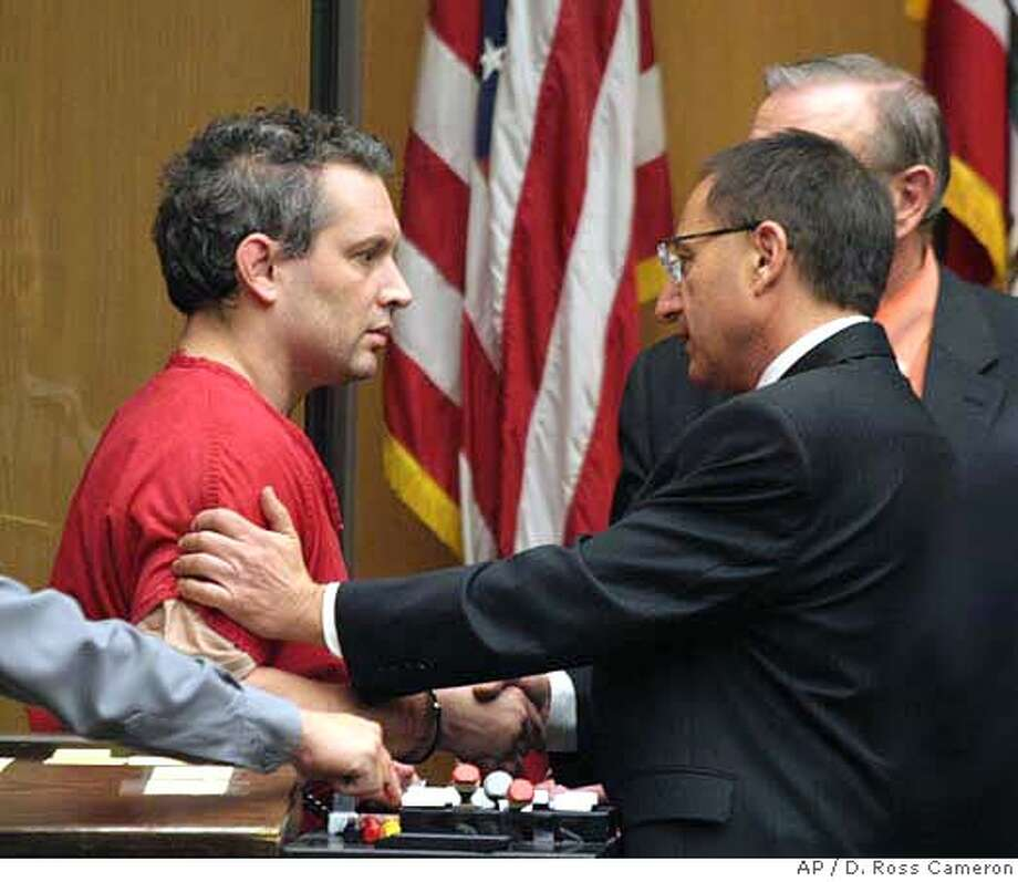 Hans Reiser, left, shakes hands with his attorneys Daniel Horowitz, front right, and William Du Bois at his arraignment on a murder charge in the disappearance of his estranged wife, Nina Reiser, Tuesday, Nov. 28, 2006, at Alameda County Superior Court in Oakland, Calif. Reiser pleaded not guilty. (AP Photo/The Oakland Tribune, D. Ross Cameron) ** , MAGS OUT, INTERNET OUT, MANDATORY CREDIT ** Photo: D. ROSS CAMERON