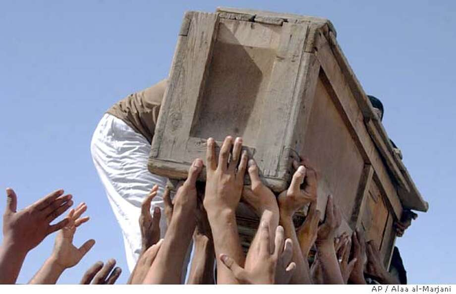 A casket of one of hundreds of pilgrims killed on Wednesday is carried during a funeral in the Shiite holly city of Najaf, Friday, Sept. 2, 2005. In the aftermath of Wednesday's mass loss of life during a Shiite pilgrimage in Baghdad, politicians from Sunni and opposition Shiite groups have denounced the government's failure to organize the processions and to quickly react following the stampede in which nearly 1,000 people died. (AP Photo/Alaa al-Marjani) Ran on: 09-03-2005  A casket of one of hundreds of pilgrims killed Wednesday is carried during a funeral in Najaf. Ran on: 09-03-2005  A casket of one of hundreds of pilgrims killed Wednesday is carried during a funeral in Najaf. Photo: ALAA AL-MARJANI