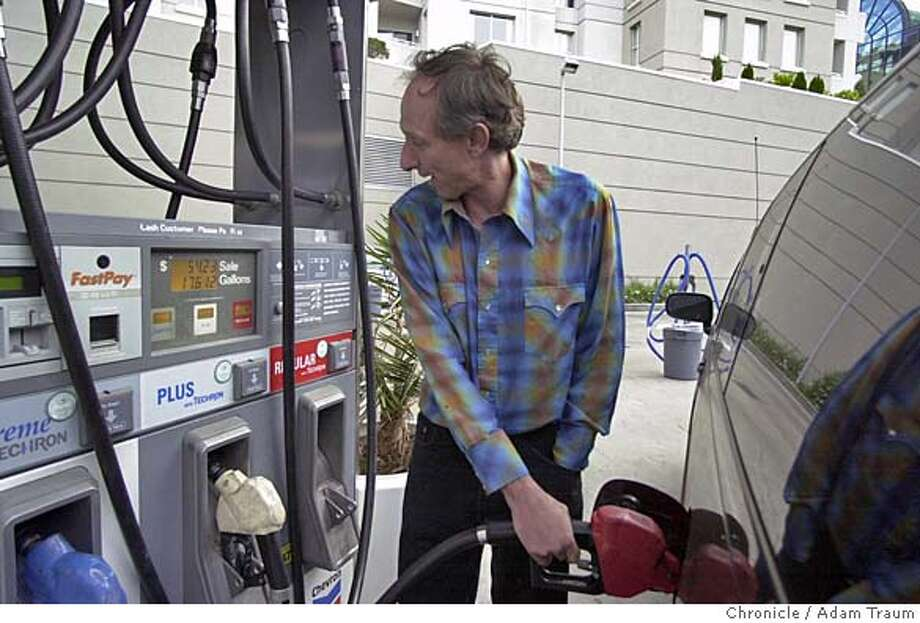 """Gas prices are averaging 3 dollars for regular unleaded at Bay Area gas stations. Here, Mark Gittus reacts to prices said """"Wow, that's a new record"""" at his 54 dollar fill up. Photo by Adam Traum/The Chronicle MAGS OUT Photo: Adam Traum/The Chronicle"""