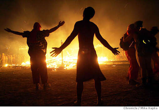 Burning seek the spirit of the man as it burns to the ground in 2005. Photo: Mike Kepka