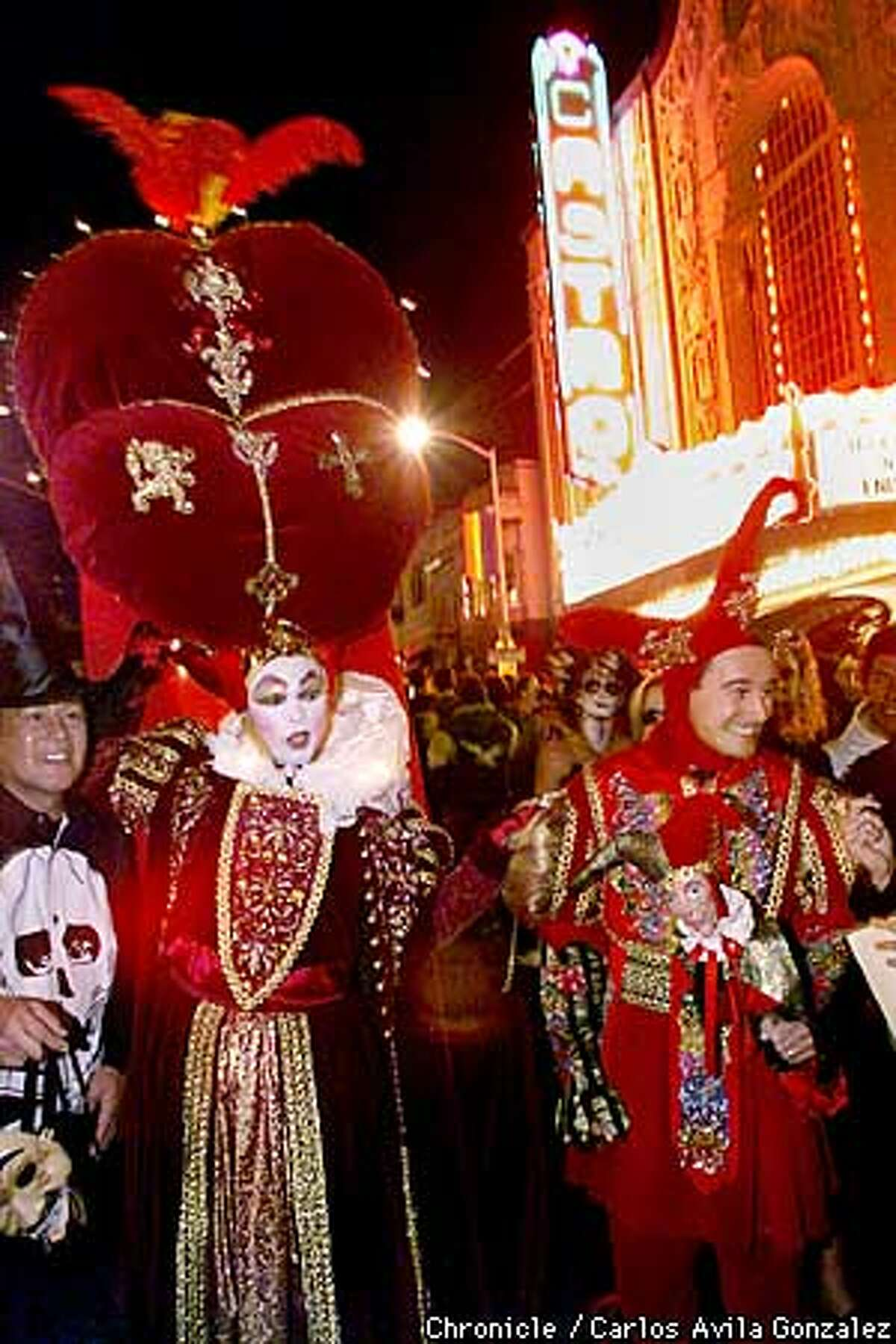 D/C/31OCT99/MN/CG --- Lawrence Ozoa, left, and Sean McCambridge as the queen and jester at San Francisco, Ca.'s, annual Castro Street celebration on Sunday, October 31, 1999. (CARLOS AVILA GONZALEZ/SAN FRANCISCO CHRONICLE)