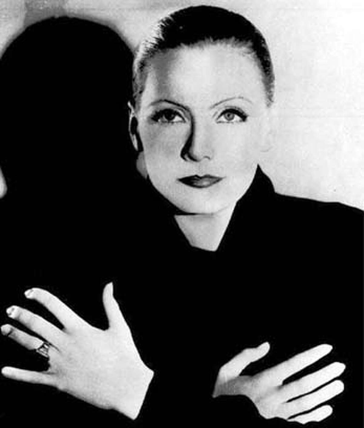 QUIT24-C-22APR03-DD-HO Shown are undated file photo,Greta Garbo. After years of a rumored love affair with Mercedes de Acosta letters from Garbo were displayed Monday, April 17, 2000, after being unsealed for the first time on Saturday, April 15, 2000 at the Rosenbach Museum and Library in Philadelphia. The 113 items that included letters, flower notes, telegrams, photos and poems chronicled a 28-year friendship of ups and downs, but gave no explicit evidence of a lesbian relationship between the two. (AP Photo/Acosta- Rosenbach Museum and Library, ho; Garbo- AP file photo) ALSO RAN 04/24/03, 03/28/2004 (dd) Buster Keaton: not smiling, still funny. CAT