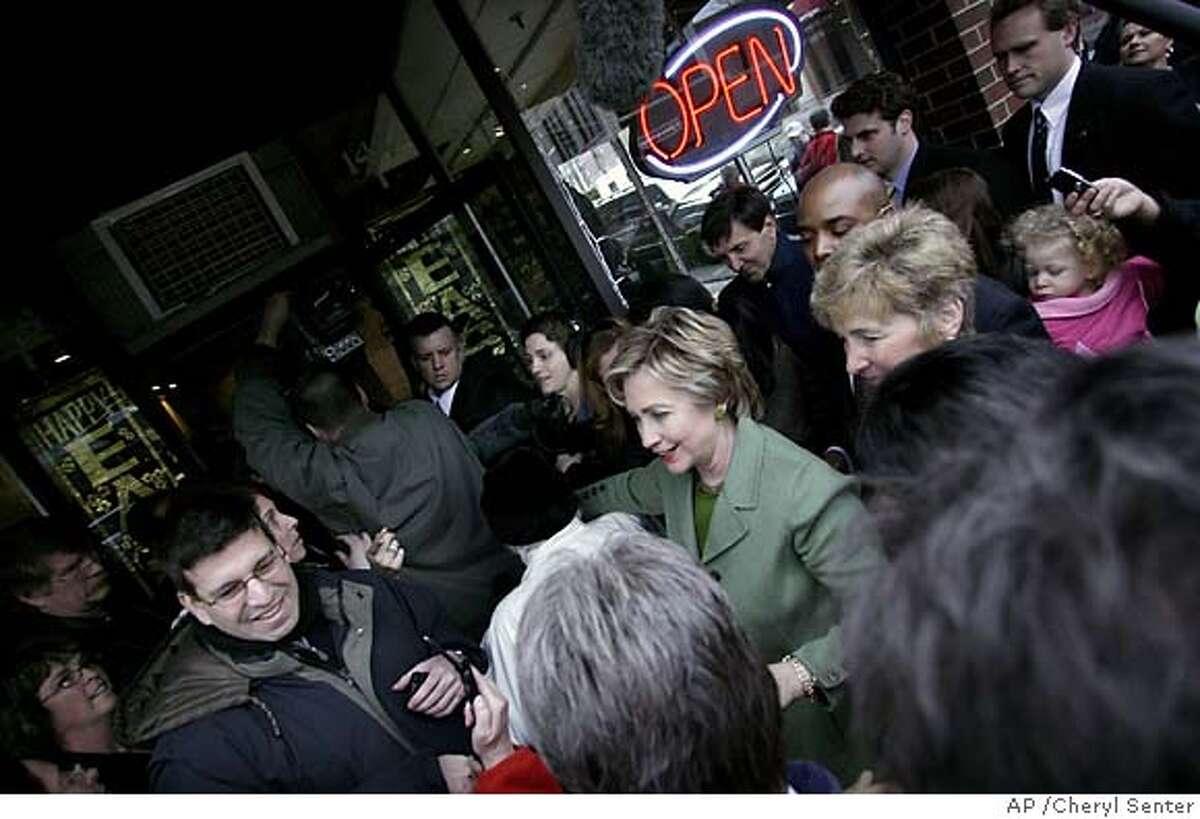 Presidential hopeful U.S. Sen. Hillary Rodham Clinton, D-N.Y., greets locals outside Swan Chocolates in Nashua, N.H. Saturday, March 10, 2007. (AP Photo/Cheryl Senter)