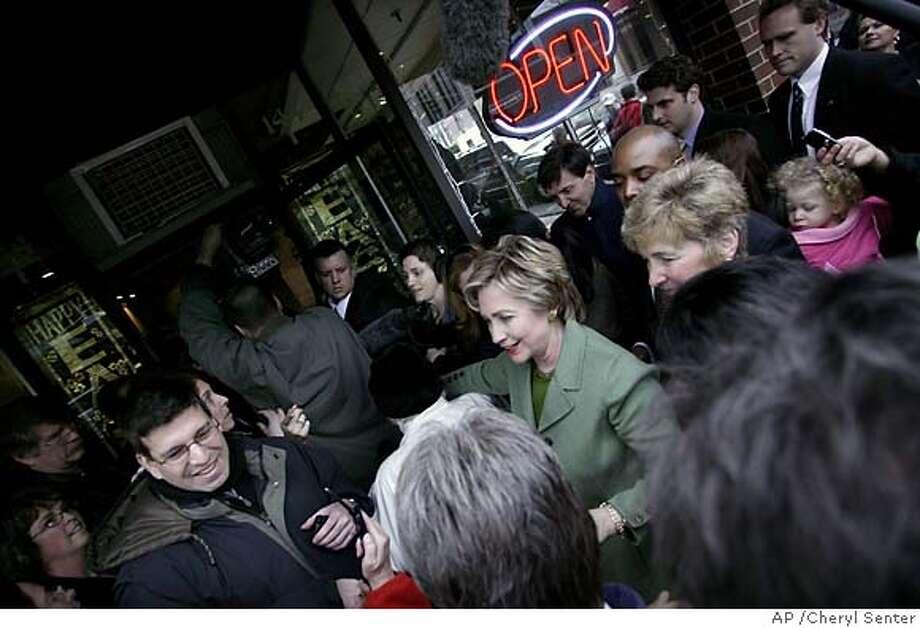 Presidential hopeful U.S. Sen. Hillary Rodham Clinton, D-N.Y., greets locals outside Swan Chocolates in Nashua, N.H. Saturday, March 10, 2007. (AP Photo/Cheryl Senter) Photo: Cheryl Senter