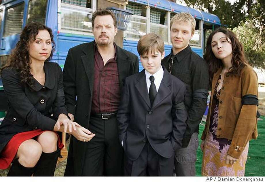 "Cast members of the new television drama series The Riches, pose, from left, Minnie Driver, Eddie Izzard, Aidan Mitchell, Noel Fisher and Shannon Woodard during a break in taping on the show's set at the Santa Clarita Studios in Valencia, Calif., Monday, Feb. 5, 2007. ""The Riches"" will premiere on March 12 on FX. (AP Photo/Damian Dovarganes) Photo: Damian Dovarganes"