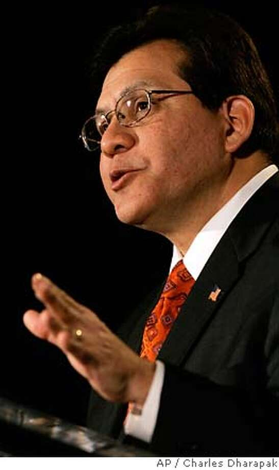 Attorney General Alberto Gonzales gestures during an address before the International Association of Privacy Professionals in Washington Friday, March 9, 2007. (AP Photo/Charles Dharapak) Photo: Charles Dharapak