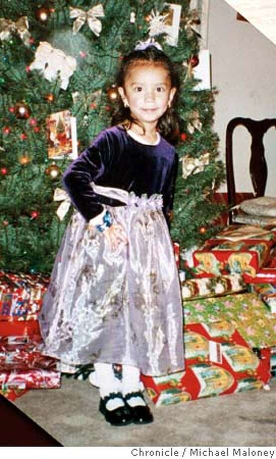 Copy photo of Elizabeth Dominguez, Christmas 2002.  A memorial was set up at 24th and Portrero for 4 year old Elizabeth Dominguez, killed the day before when a truck spun out of control and pinned her against the side of a restaurant. Photo: MICHAEL MALONEY
