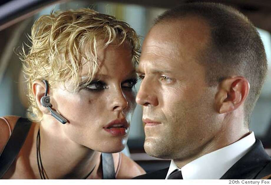 TRANSPORTER02 Lola (KATE NAUTA) quietly threatens the implacable Frank Martin (JASON STATHAM) in Transporter 2. 20th Century Fox