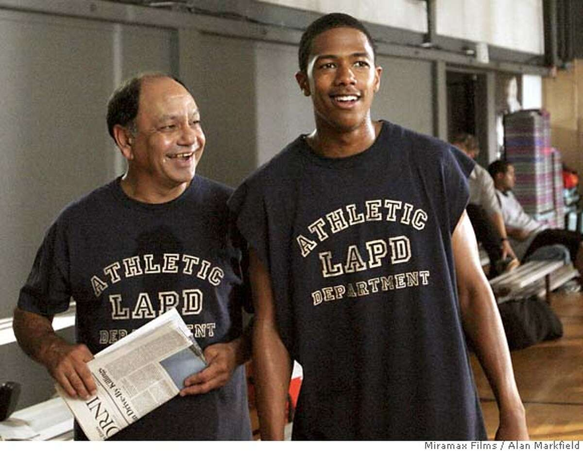 """In this photo provided by Miramax Films, Captain Victor Delgado (Cheech Marin,left) helps Tracy Stokes ( Nick Cannon) go undercover in an elite private school in """"Underclassman."""" (AP Photo/Miramax Films/Alan Markfield)"""
