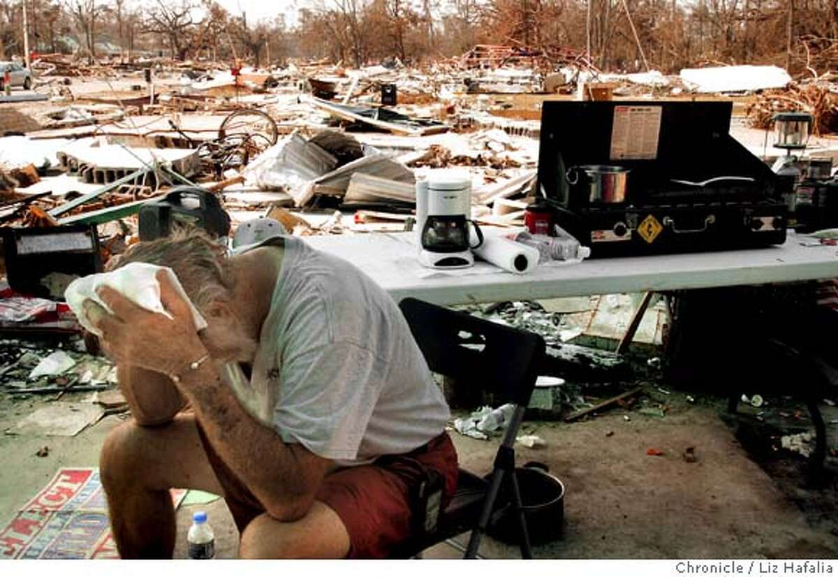 WAVELAND_269_LH.JPG Bill Laprime, who ran for mayor four years ago, wipes the sweat off his face in the heat. He lost his house and is one of two people in the center of town staying near his property. Hurricane Katrina, ground zero at beachfront community Waveland. Photographed by Liz Hafalia on 9/4/05 in Waveland, Mississippi