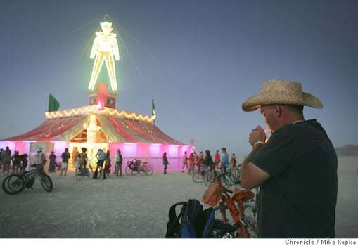 "Brian Stone of Winnemucca, NV lights a cigarette at the base of the 2005 Man. ""Its crazy. Society should be like this,"" Stone said.  Photo: Mike Kepka"