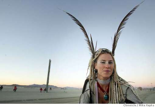 "Mo Murphy of Arcata at her first Burning Man in 2005. ""Its like another planet out here. People can make their little fantasies come true here.""  Photo: Mike Kepka"