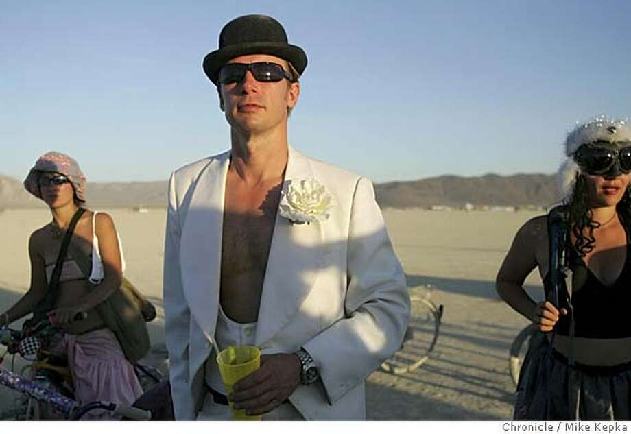 Paul Neale of Denmark attends the weding of Chelsea Reilly Teller and Howard Chen of Seattle. burning man - burnman2005  Event on 9/1/05 in Black Rock City. Mike Kepka / The Chronicle Photo: Mike Kepka
