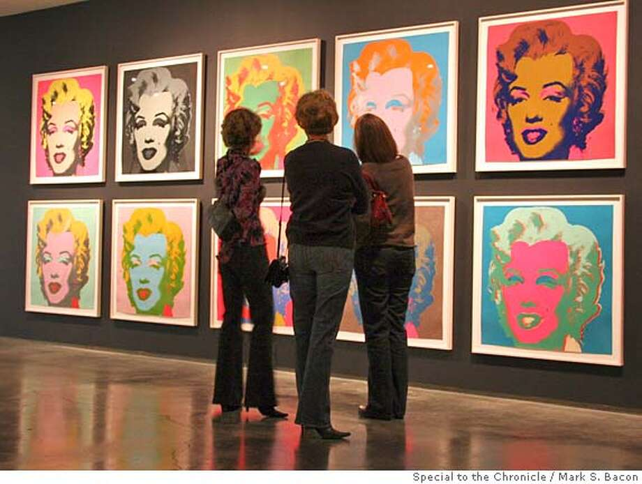 "Marilyn Monroes in a rainbow of shades greet visitors to ""Andy Warhol's Dream America"" an exhibition of the controversial artist's screen prints at the Nevada Museum of Art in Reno.  Photo by Mark S. Bacon, special to The Chronicle Ran on: 03-11-2007  Multiple Marilyns are in &quo;Andy Warhol's Dream America&quo; at Reno's Nevada Museum of Art. Photo: Mark S. Bacon"