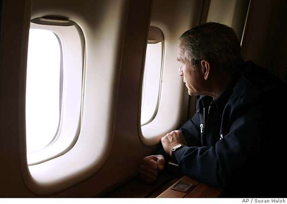 President Bush looks out the window of Air Force One inspecting damage from Hurricane Katrina while flying over New Orleans en route back to the White House, Wednesday, Aug. 31, 2005. (AP Photo/Susan Walsh) Photo: SUSAN WALSH