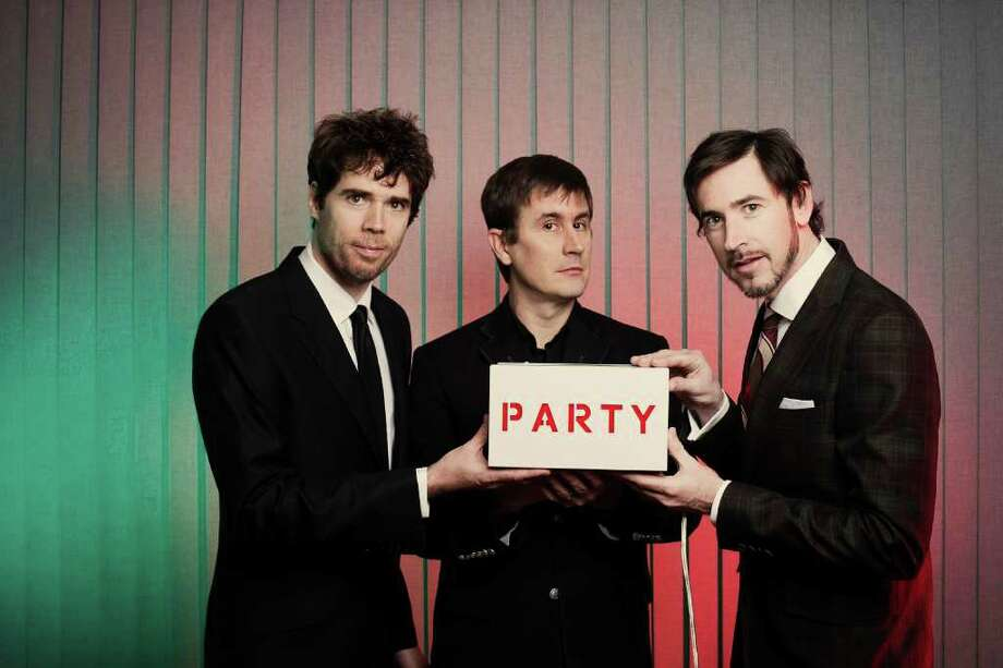 From left to right, the Mountain Goats are Jon Wurster, Peter Hughes and John Darnielle. Photo: D.L. Anderson / D.L. Anderson © 2010
