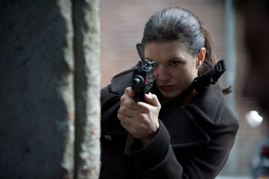 "Gina Carano, a mixed  marital arts fighter, plays a wronged operative seeking revenge in ""Haywire.""