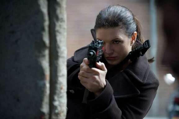 """Gina Carano, a mixed marital arts fighter, playes a wronged operative seeking revenge in """"Haywire."""""""