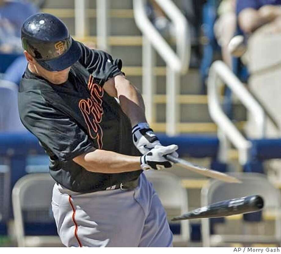 San Francisco Giants' Scott McClain breaks his bat as he pops out during the fourth inning of a spring training baseball game against the Milwaukee Brewers, Thursday, March 8, 2007, in Phoenix. (AP Photo/Morry Gash) Photo: Morry Gash