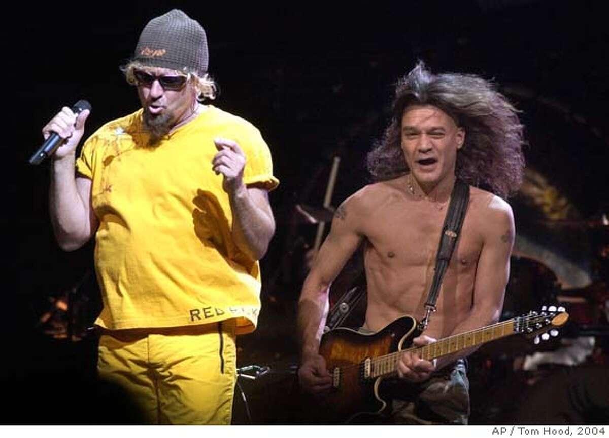 Van Halen members Sammy Hagar, left, and Eddie Van Halen perform at America West Arena in Phoenix, Thursday, Aug. 5, 2004. (AP Photo/Tom Hood) STAND ALONE