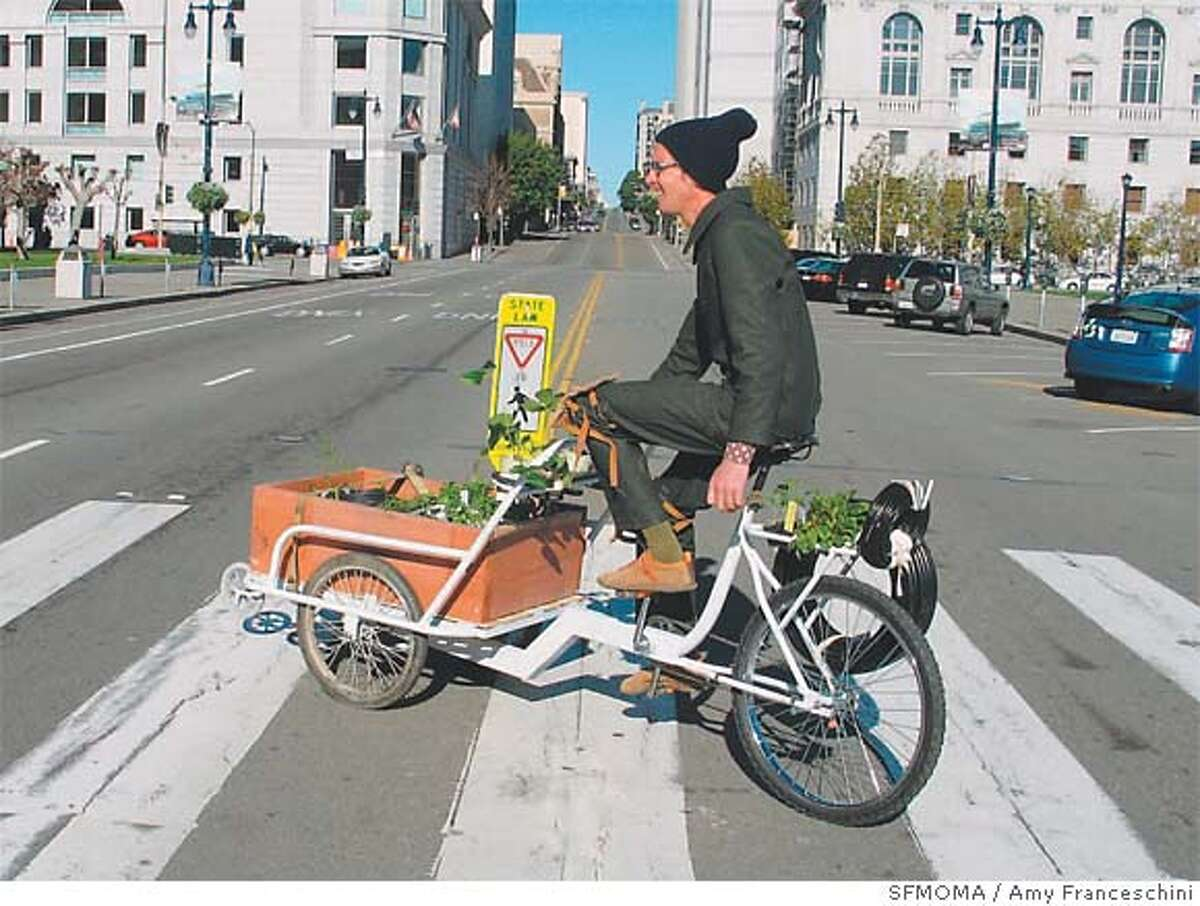 Arcangelo Wessels, one of artist-activist Amy Franceschini�s many volunteer gardeners, rides Franceschini�s Victory garden trike in the vicinity of San Francisco City Hall. Photo courtesy of SF MOMA / Amy Franceschini