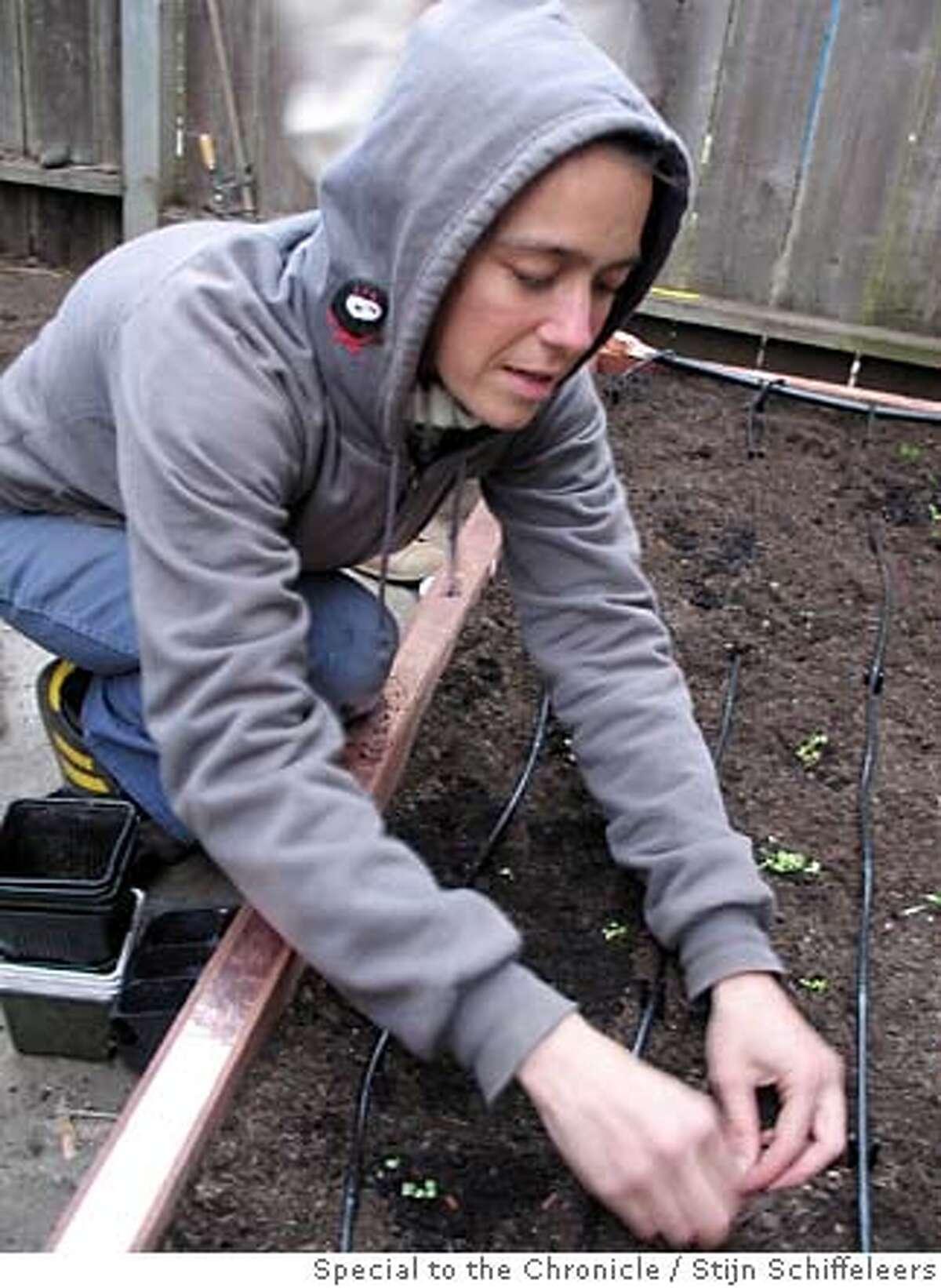 Amy Franceschini at work in the garden.