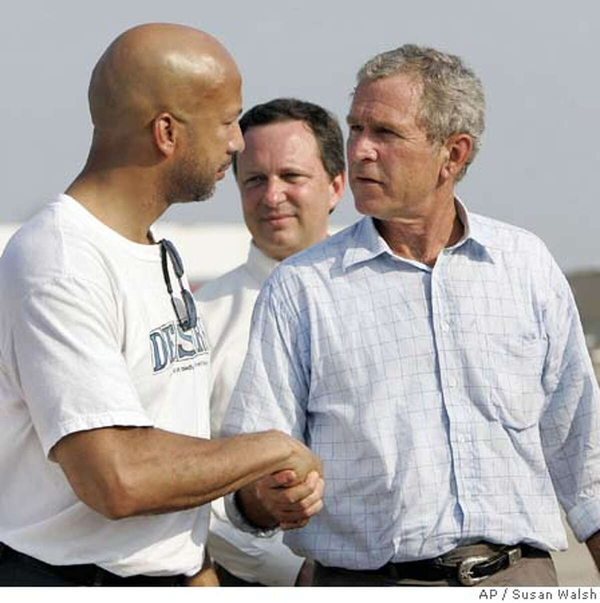 President Bush meets New Orleans mayor Ray Nagin following a news conference at the Louis Armstrong New Orleans International Airport, Friday, Sept. 2, 2005. Bush is touring the Gulf Coast communities battered by Hurricane Katrina, hoping to boost the spirits of increasingly desperate storm victims and exhausted rescuers. (AP Photo/Susan Walsh)