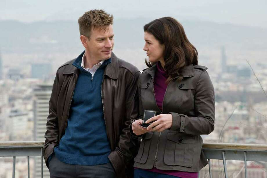 """In this film image released by Relativity Media, Gina Carano and Ewan McGregor are shown in a scene from """"Haywire."""" (AP Photo/Relativity Media, Claudette Barius) Photo: Claudette Barius / ©2011 Five Continents Imports, LLC. All Rights Reserved"""
