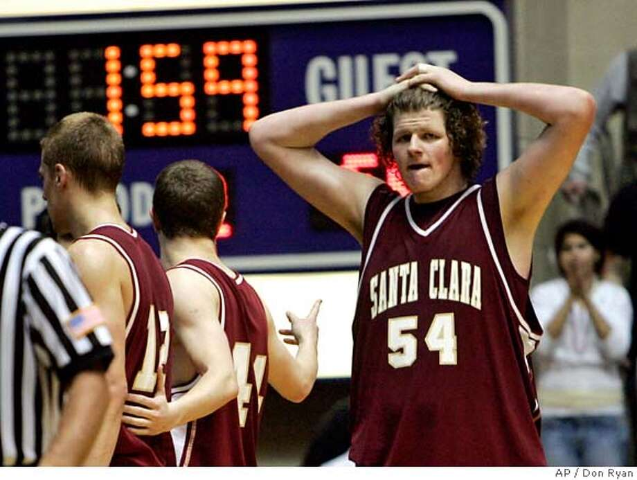 Santa Clara center John Bryant, right, stands with hands on head after fouling out with just under two minutes to go during their West Coast Conference men's final basketball game against Gonzaga in Portland, Ore., Monday, March 5, 2007. Santa Clara lost to Gonzaga 77-68. (AP Photo/Don Ryan) Photo: Don Ryan
