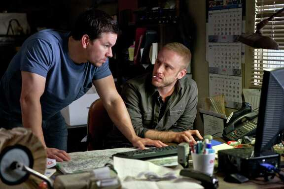 Mark Wahlberg, left, and Ben Foster star in last weekend's No. 1 film, Contraband.