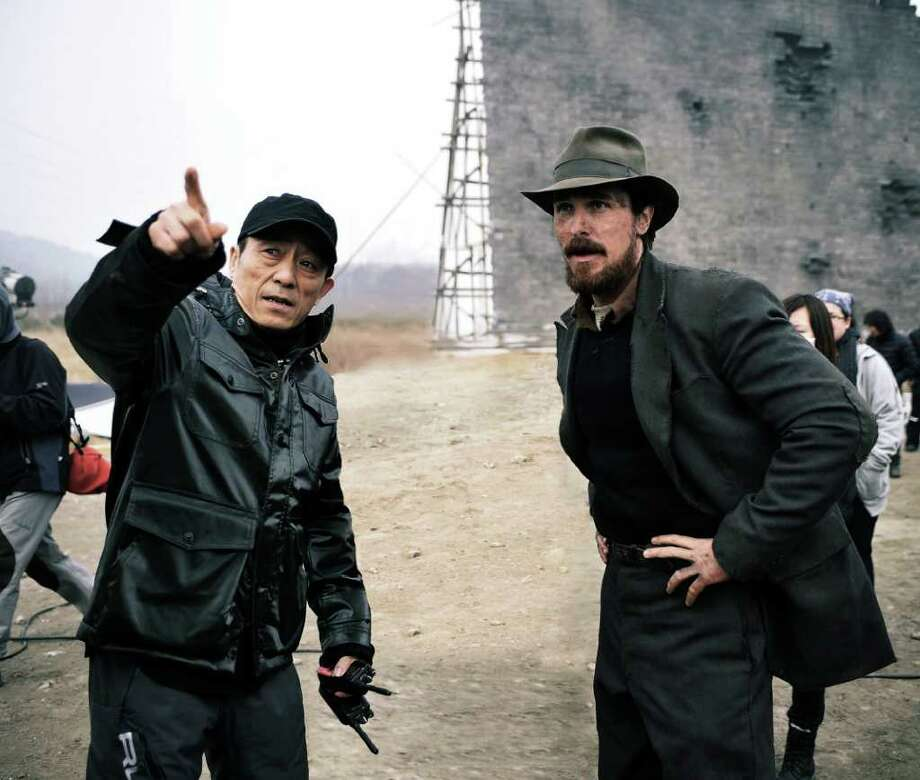 Oscar-nominated director Zhang Yimou goes over a scene with Christian Bale on the set of The Flowers of War. Photo: Wrekin Hill Entertainment / WREKIN HILL ENTERTAINMENT