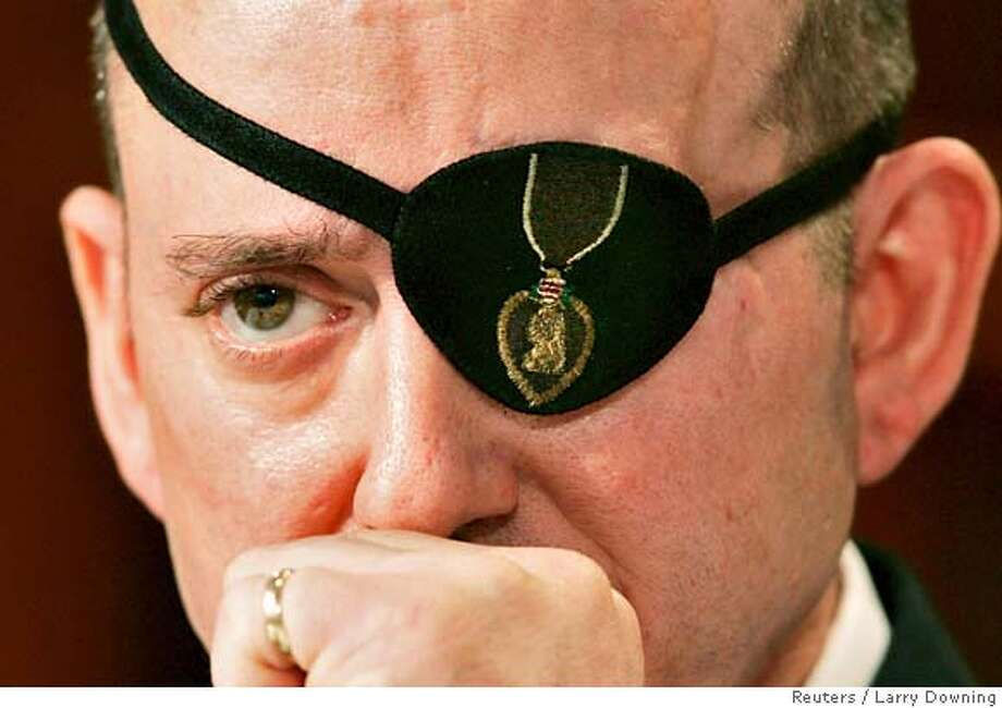 "Wounded U.S. Army Sergeant John Daniel Shannon testifies before a U.S. House subcommittee entitled ""Is This Any Way To Treat Our Troops? The Care and Conditions of Wounded Soldiers at Walter Reed"" at Walter Reed Army Medical Center in Washington, March 5, 2007. The patch on his left eye is embroidered with the Purple Heart. REUTERS/Larry Downing (UNITED STATES) 0 Photo: LARRY DOWNING"