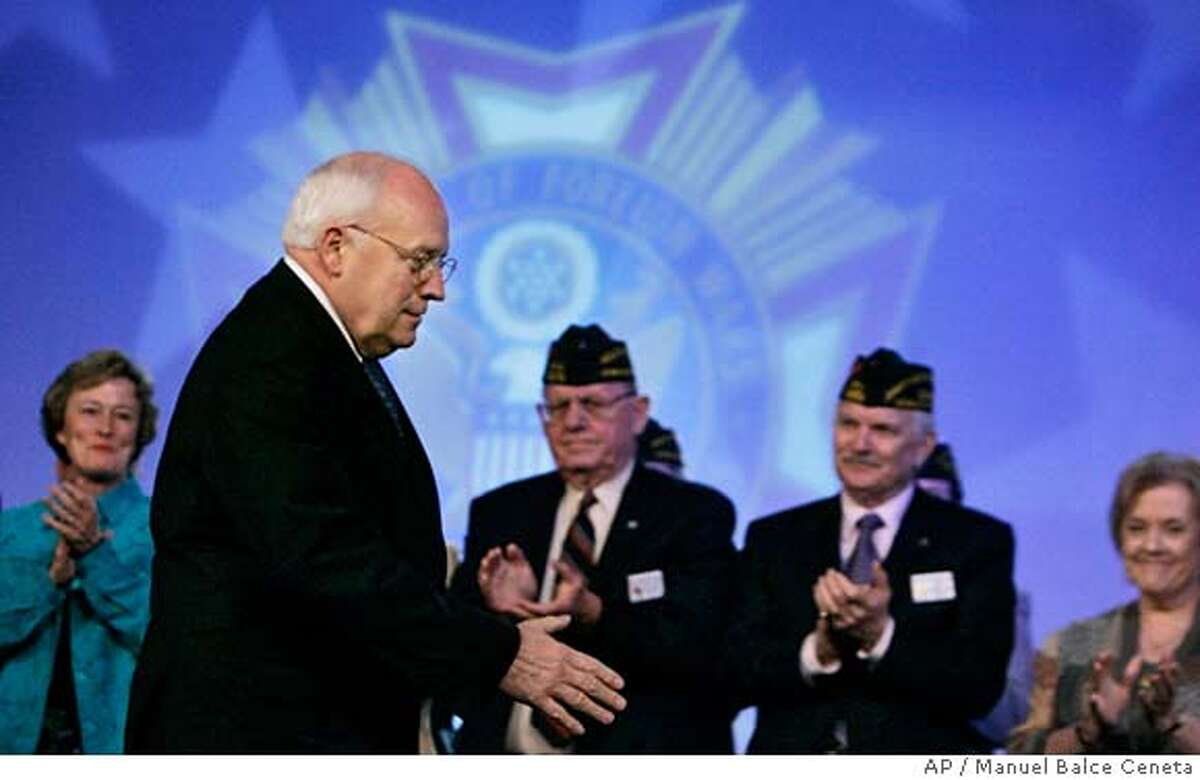 Vice President Dick Cheney is applauded as he arrives at a joint opening session of Veterans of Foreign Wars and Ladies Auxiliary National Community Service Conference national legislative conference, Monday, March 5, 2007, in Washington. During his address, Cheney promised that the problems at tje Walter Reed Army Medical Center will be fixed. Substandard living conditions found at the Army's flagship veterans hospital likely exist throughout the military health care system, the head of a House panel investigating Walter Reed Army Medical Center said Monday. (AP Photo/Manuel Balce Ceneta)